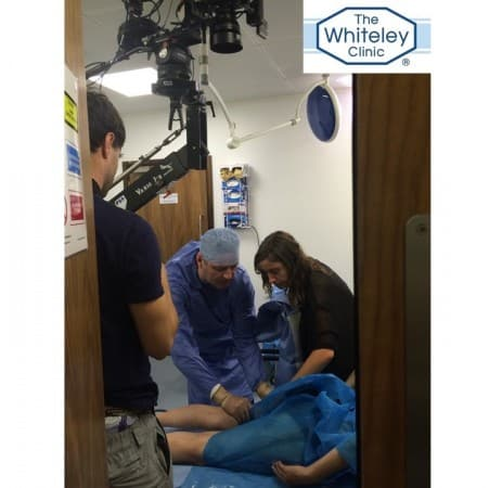 Prof Mark Whiteley and Producer Emily Rudge preparing a scene during the Filming of Blue Roses - a Marianna Simnett Film at The Whiteley Clinic in Bond Street, London