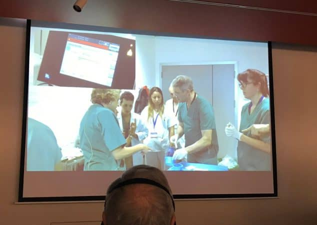 Prof Mark Whiteley and Vascular Technologist Eluned (Lyn) Davies operating live on a patient with varicose veins and a leg ulcer in Madrid - November 2018