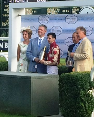 Prof Mark Whiteley and Vicki Smith presenting Jockey Martin Harley champagne The Whiteley Clinic Stakes 2016 at Goodwood