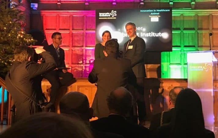 Prof Mark Whiteley presenting Pirbright Institute with the Innovation in Healthcare Award - Animal - Guildford December 2018